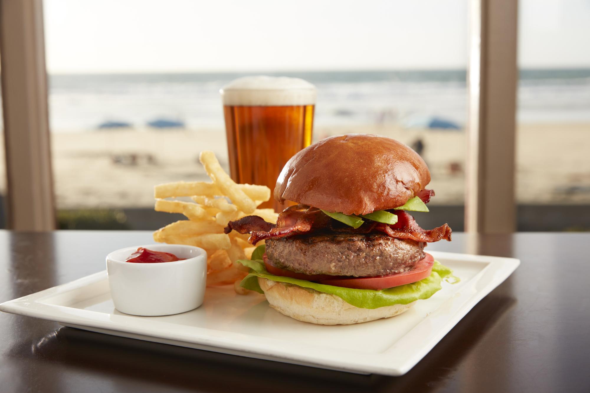 Shores Burger : 14.95 smoked cheddar, charred onion, grain mustard at Shores Restaurant, The