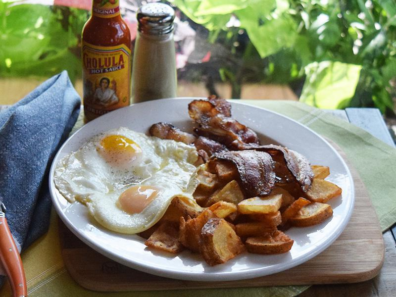 American Breakfast - Two Eggs your way, sausage or bacon, fried potatoes, and toast at West Allis Cheese & Sausage Shoppe