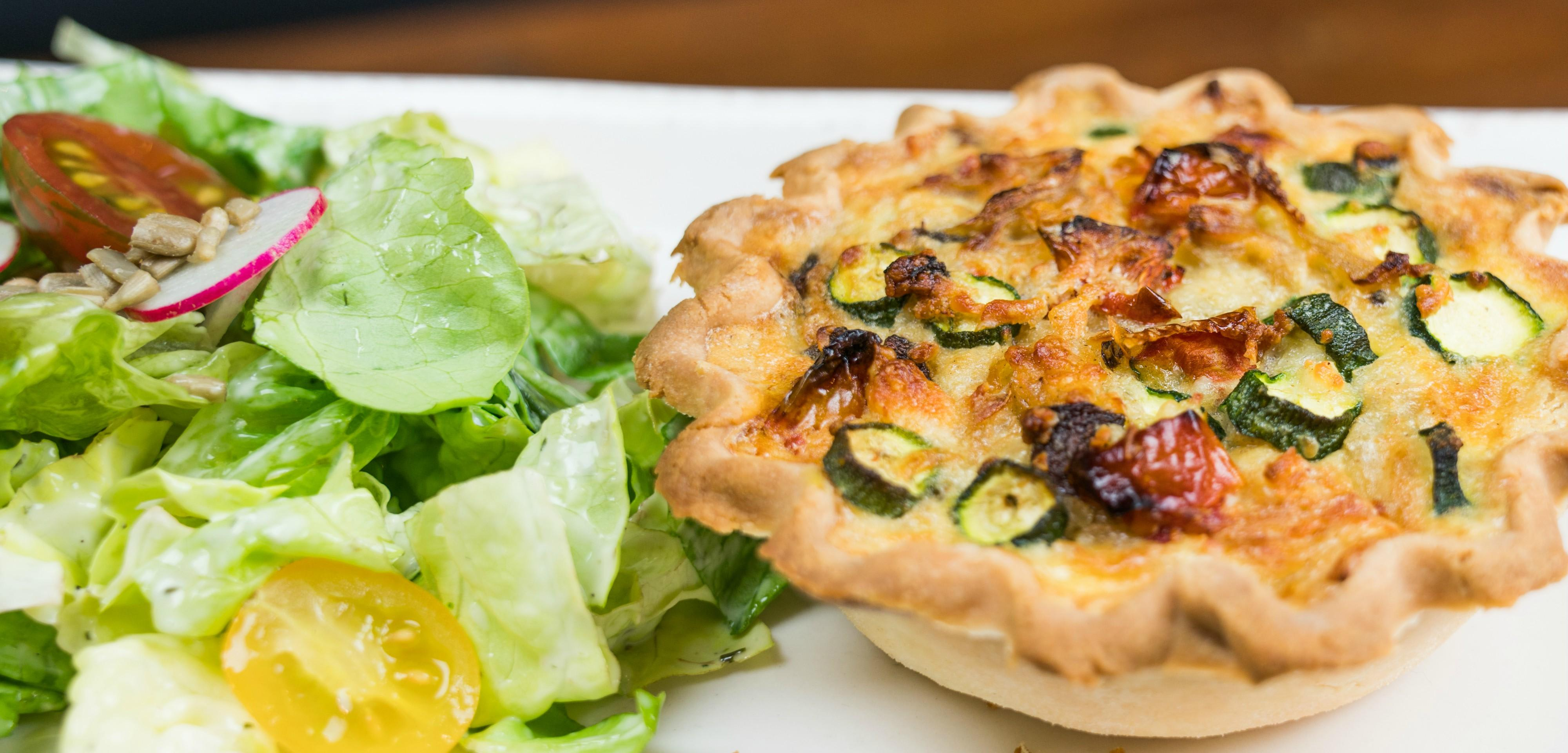 Rancho Quiche Please inquire, served with our house salad at Tonto Bar & Grill