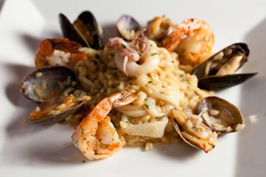 saffron scented risotto, prawns, scallops, calamari, crustacean fumé at Zingari Ristorante