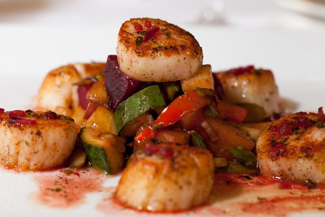 jumbo scallops, roasted red and golden beets, carrots, squash, zucchini, lemon thyme jus at Zingari Ristorante