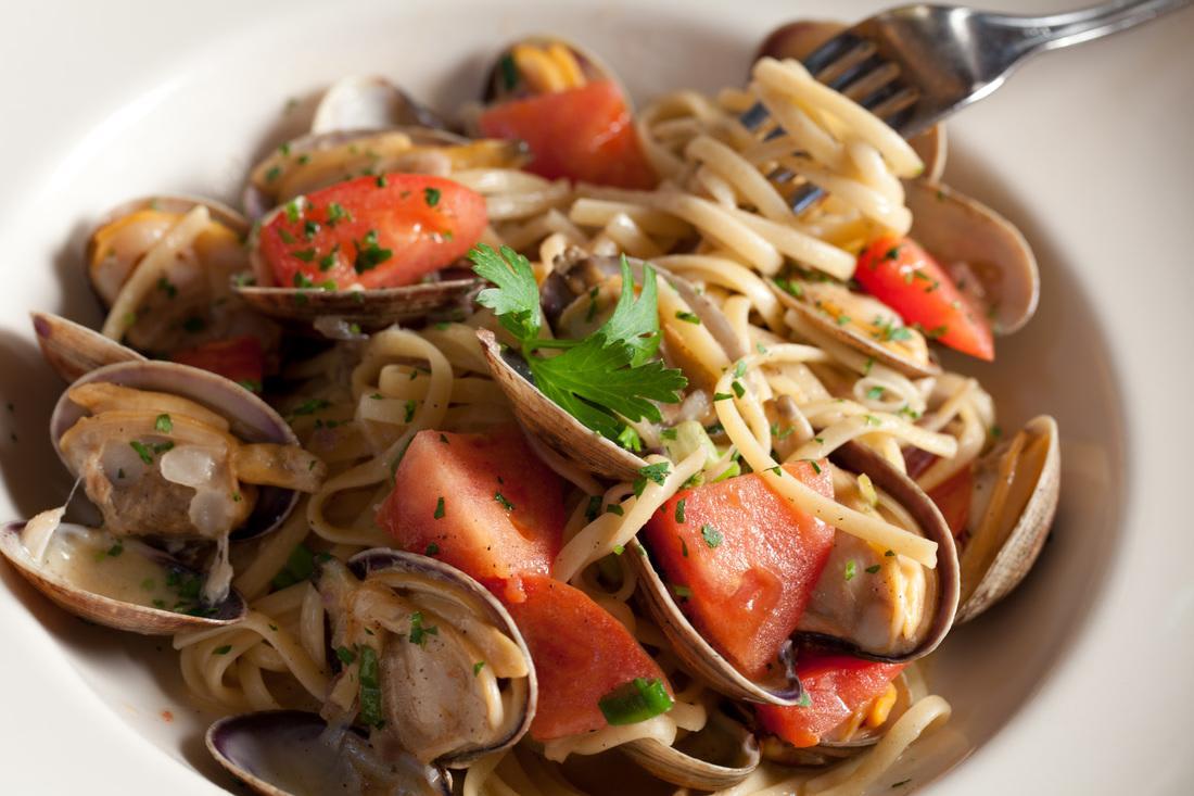 linguine, prawns, scallops, mussels, clams, calamari, spiced garlic marinara at Zingari Ristorante