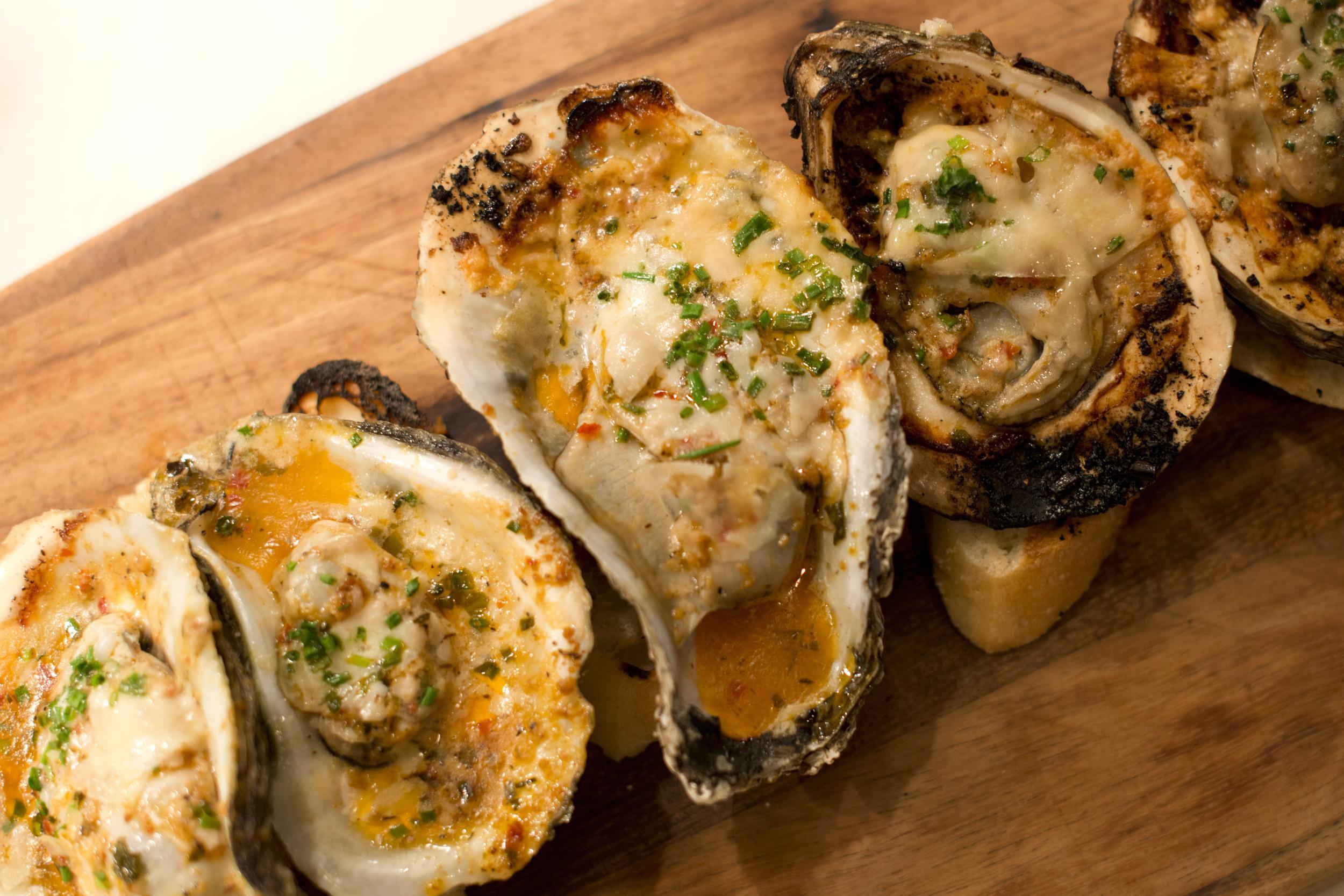 half dozen garlic and pecorino chard market oysters, lemon drops at Ariccia Italian Trattoria & Bar