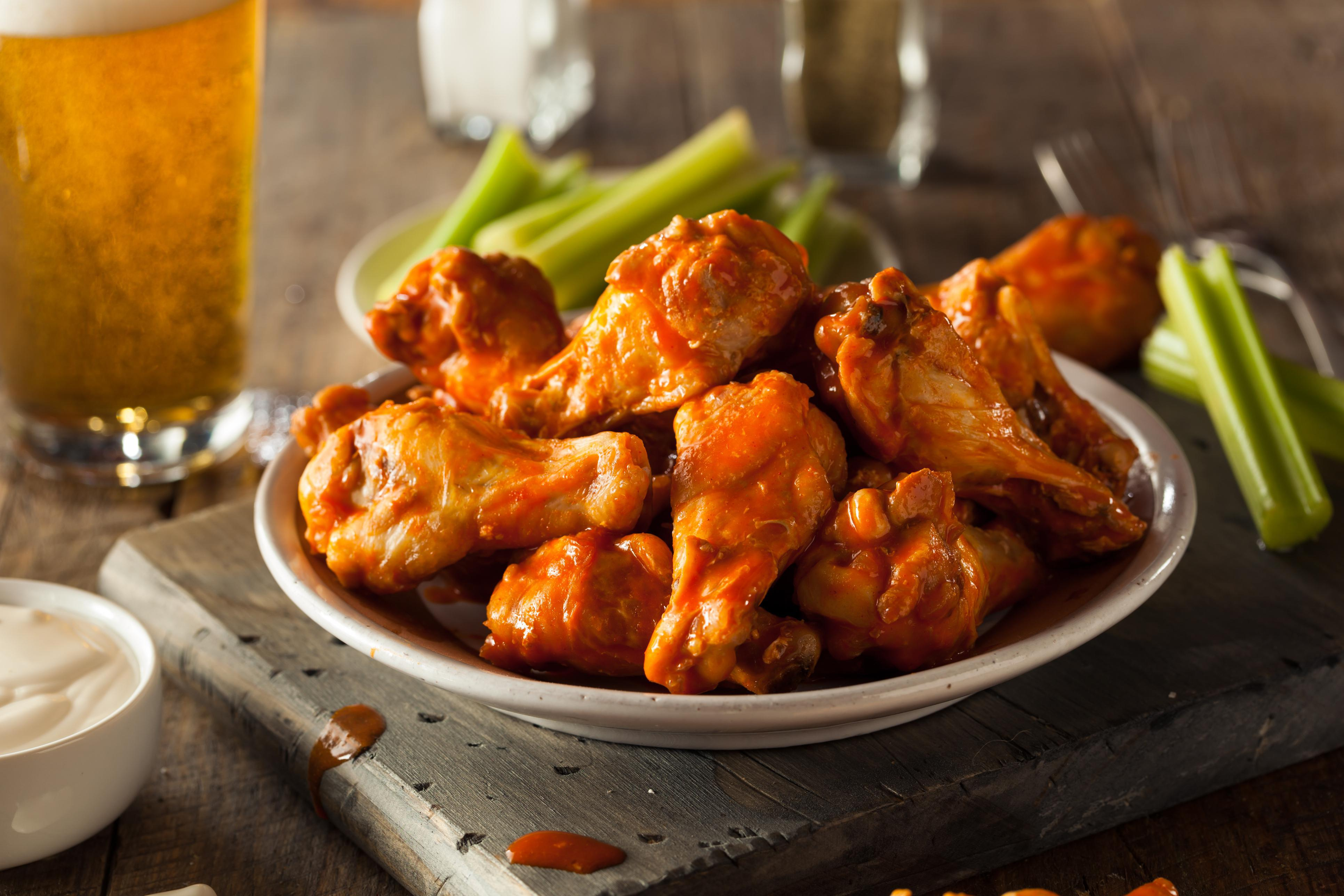 Chicken Wings with a choice of chipotle barbeque or traditional hot served with veggies and blue cheese or ranch dressing at Hotel Indigo San Diego