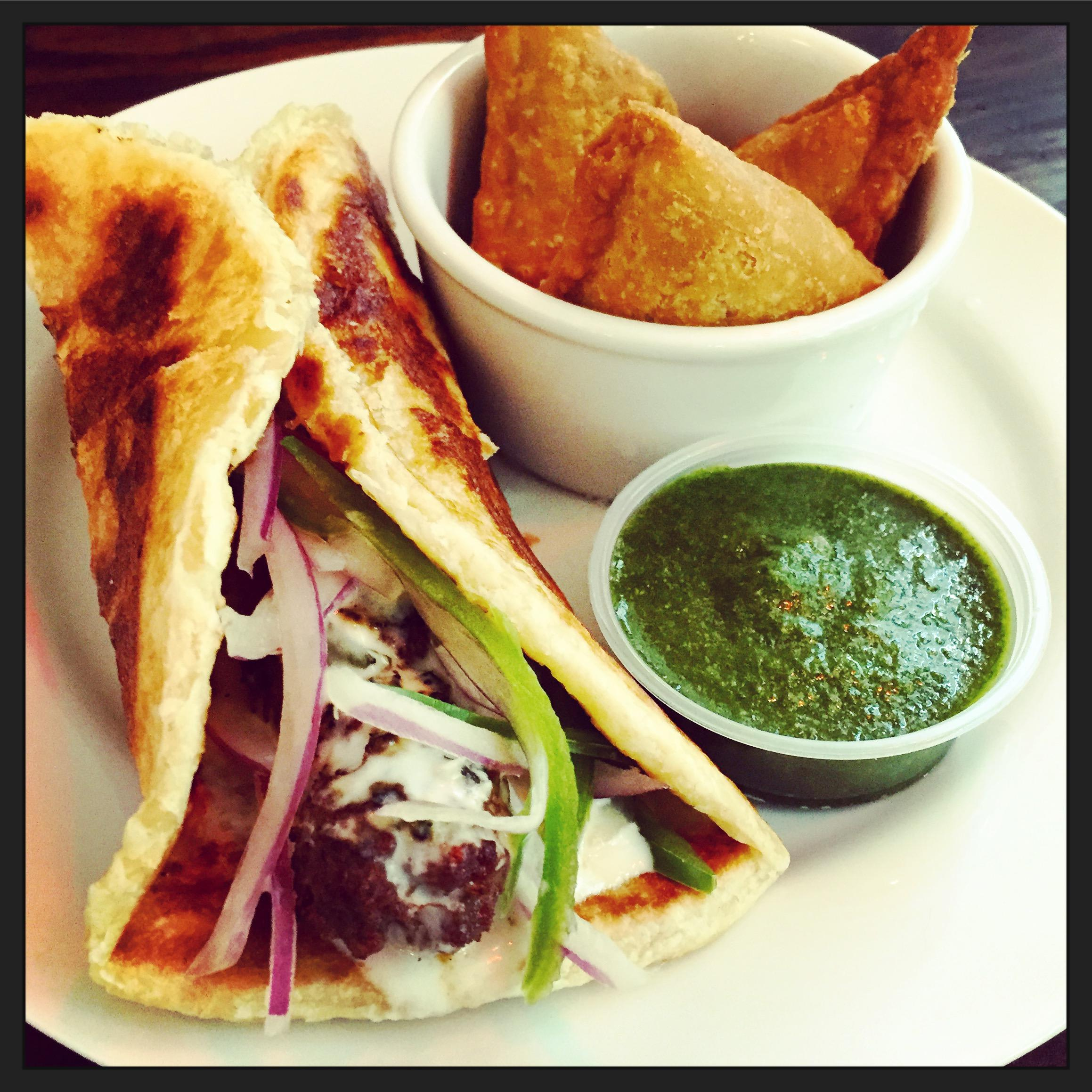 Beef Kebab with cool yogurt & finished with shredded cabbage, lettuce & jalapenos at Bombay Wraps