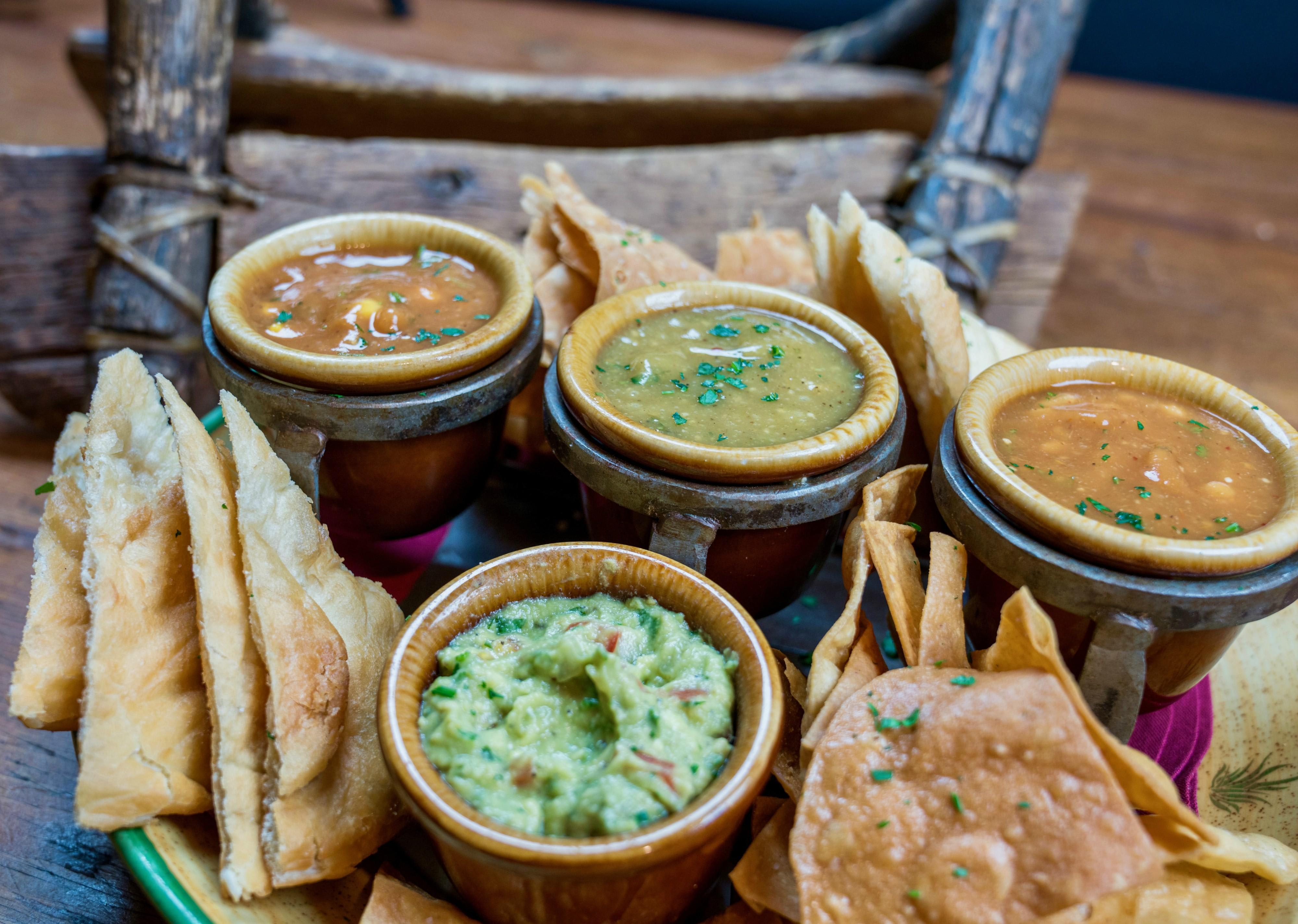 Three Sister Salsas & Guacamole Trio of chips: Corn, flour & fry bread Salsas of: – Corn & tomato – Chayote squash & tomatillo – Tepary bean & red chilies at Tonto Bar & Grill