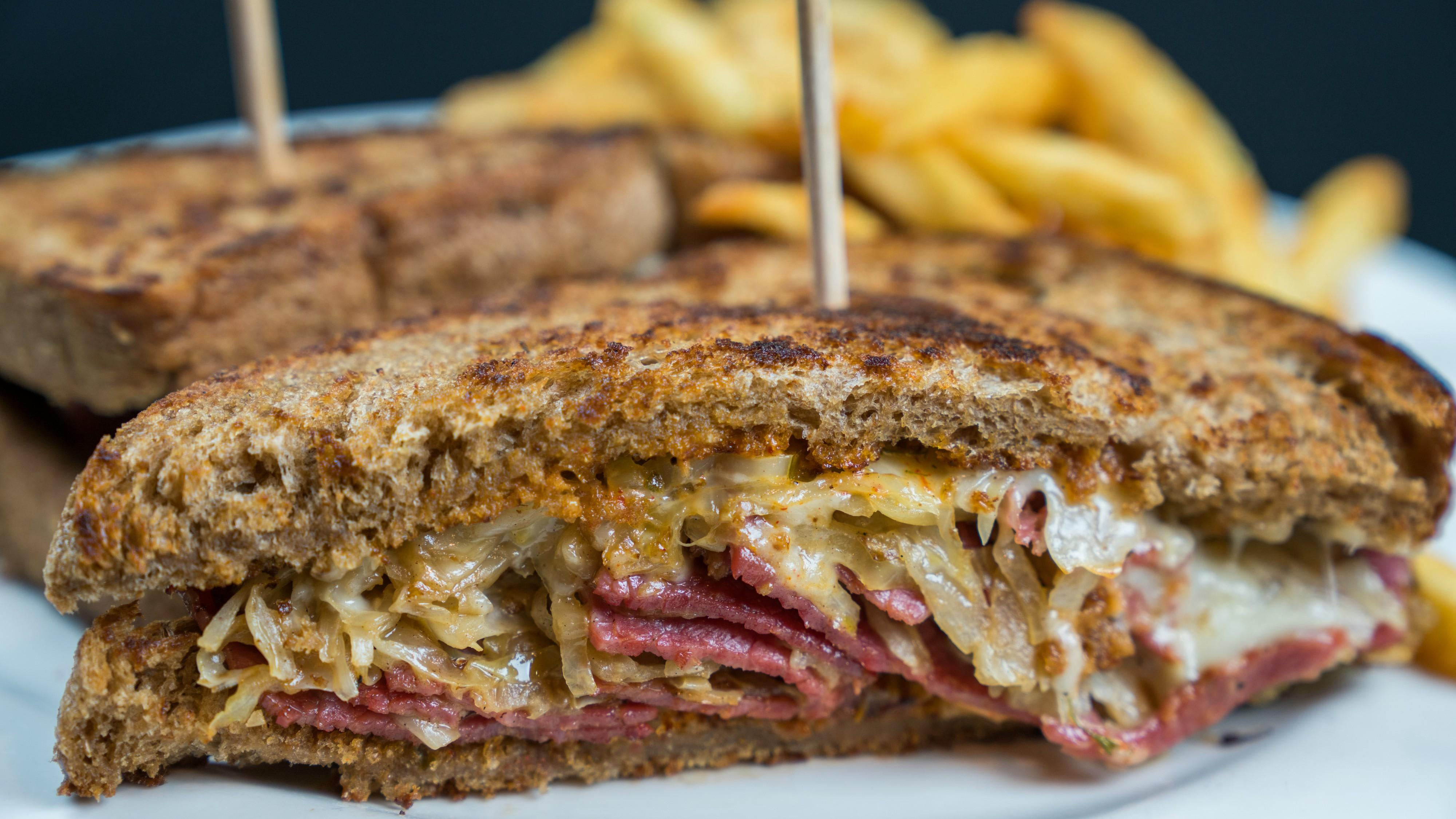 Reuben with Giddy-Up House-made corned beef & cider sauerkraut, 1,000 island dressing, Jarlsberg cheese, fresh pickled jalapeños on Amanda's rye bread at Tonto Bar & Grill