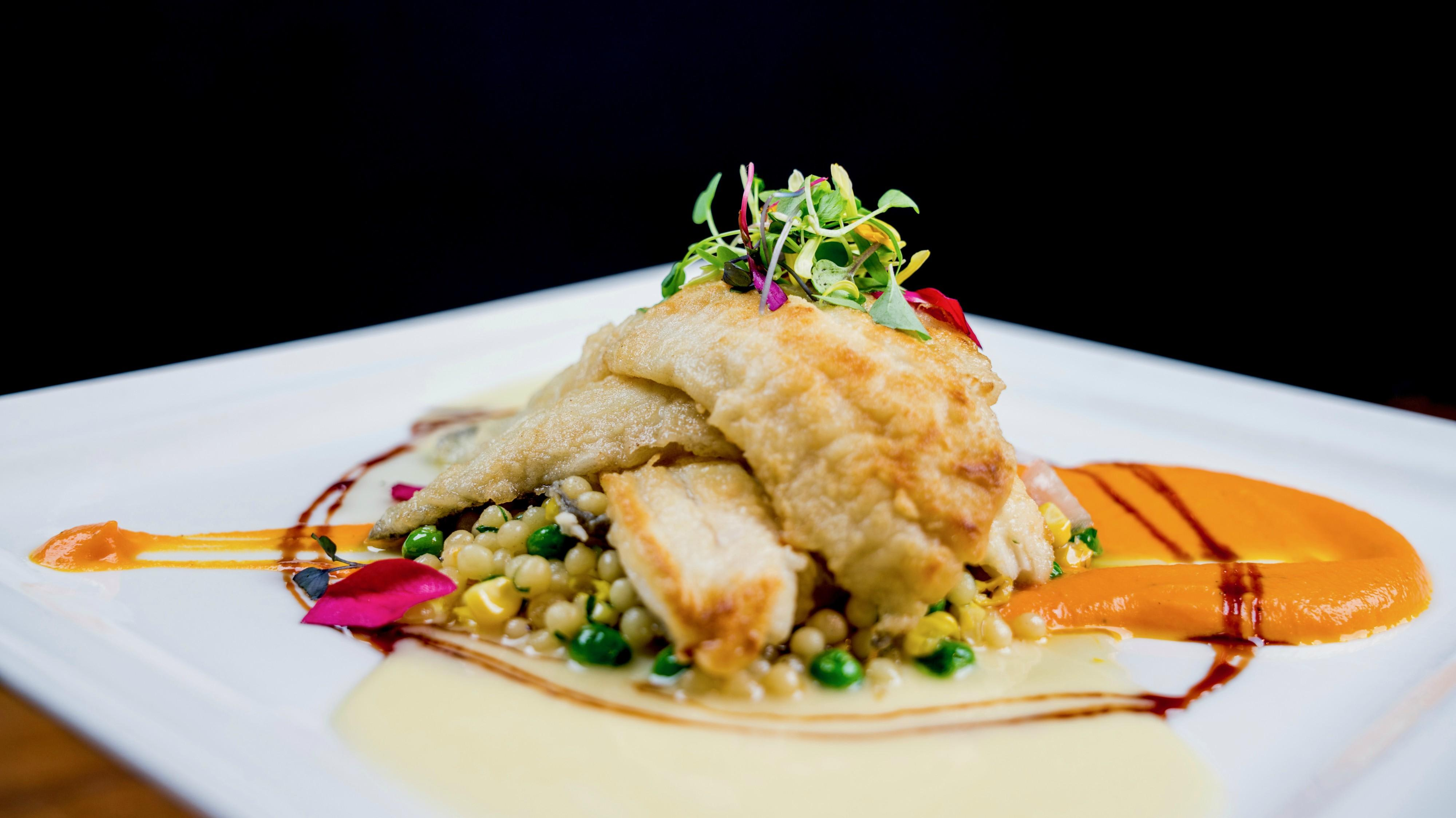 Sautéed Pacific Coast Sand Dabs Pearled cous cous with fresh peas and charred local corn, heirloom carrot puree, pomegranate gastrique, sauvignon blanc citrus butter at Tonto Bar & Grill