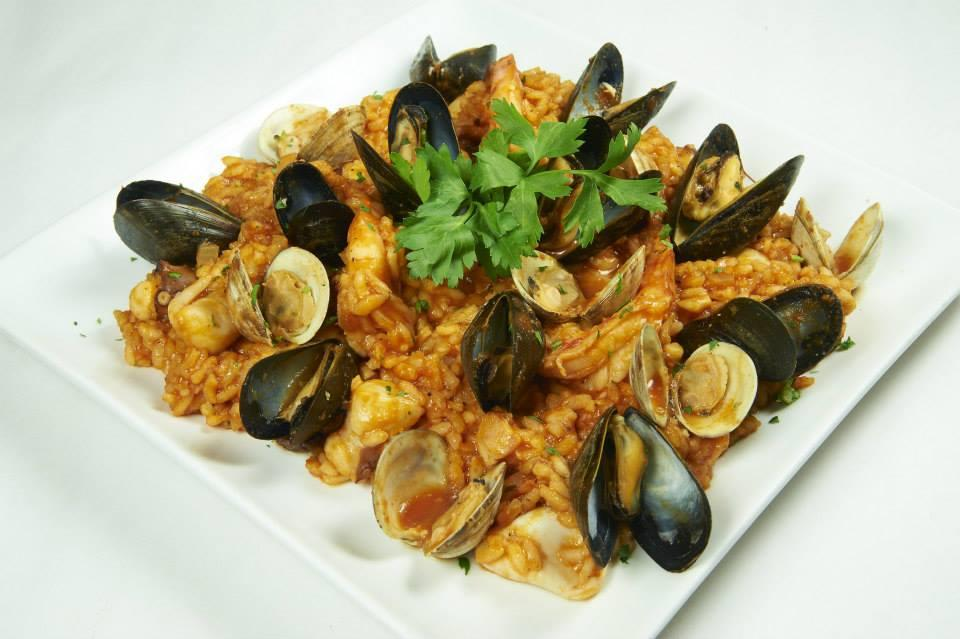 Arborio rice folded with clams, mussels, shrimp, calamari, octopus and bay scallops served in a lightly spiced tomato sauce at Pasta D'arte