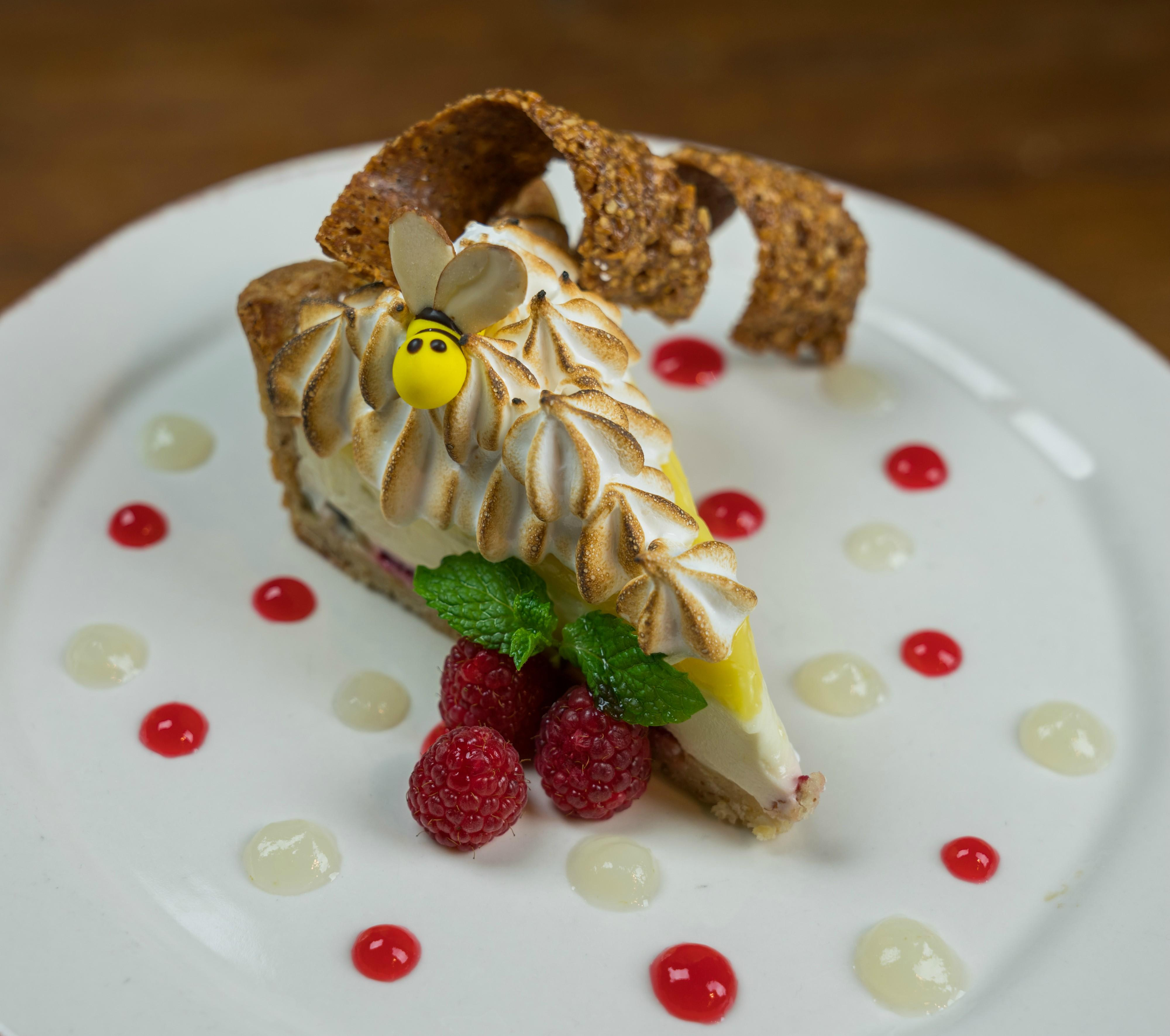 Lemon-Lime Sour Cream Meringue Pie Raspberries & sliced kiwi, baked in an almond crust at Tonto Bar & Grill