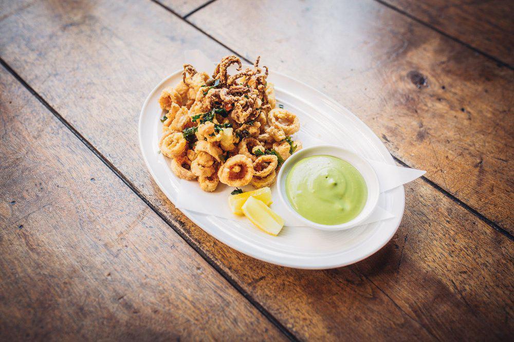 Crispy Fried Calamari with Capers, Parsley, Lemon, & Gremolata Aioli at Wolfgang Puck Bar & Grill