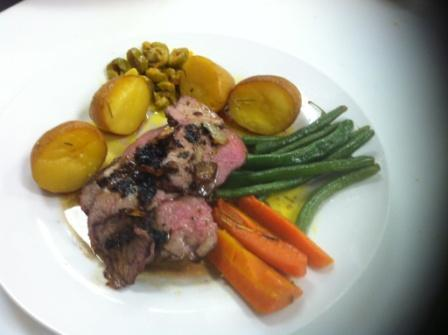 Juicy lamb chops with flavorful vegetables at Yaffa's Savory