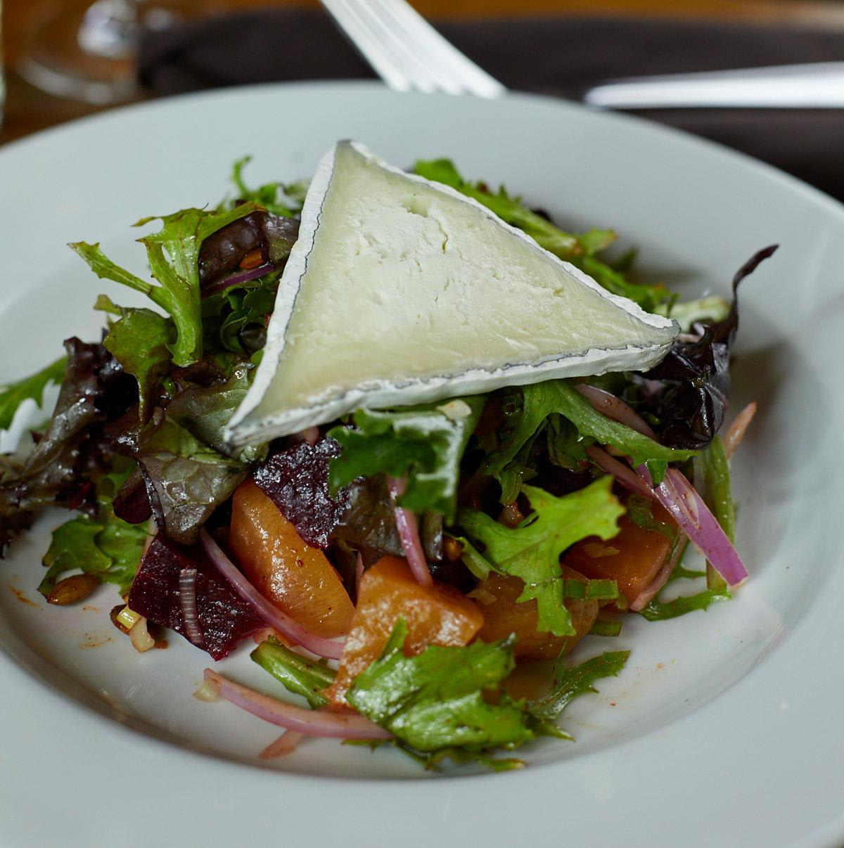 Humboldt Fog Goat Cheese, Mixed Greens, Red & Green Onion Chili Dusted Pumpkin Seeds & Citrus Vinaigrette at Sauce: Belden Place