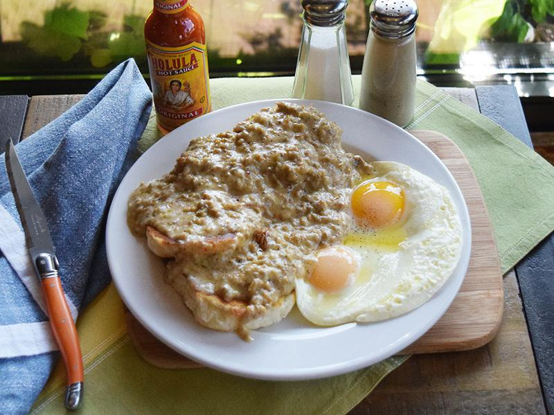 Biscuits & Gravy - Two biscuits smothered in sausage gravy and served with two eggs your way at West Allis Cheese & Sausage Shoppe