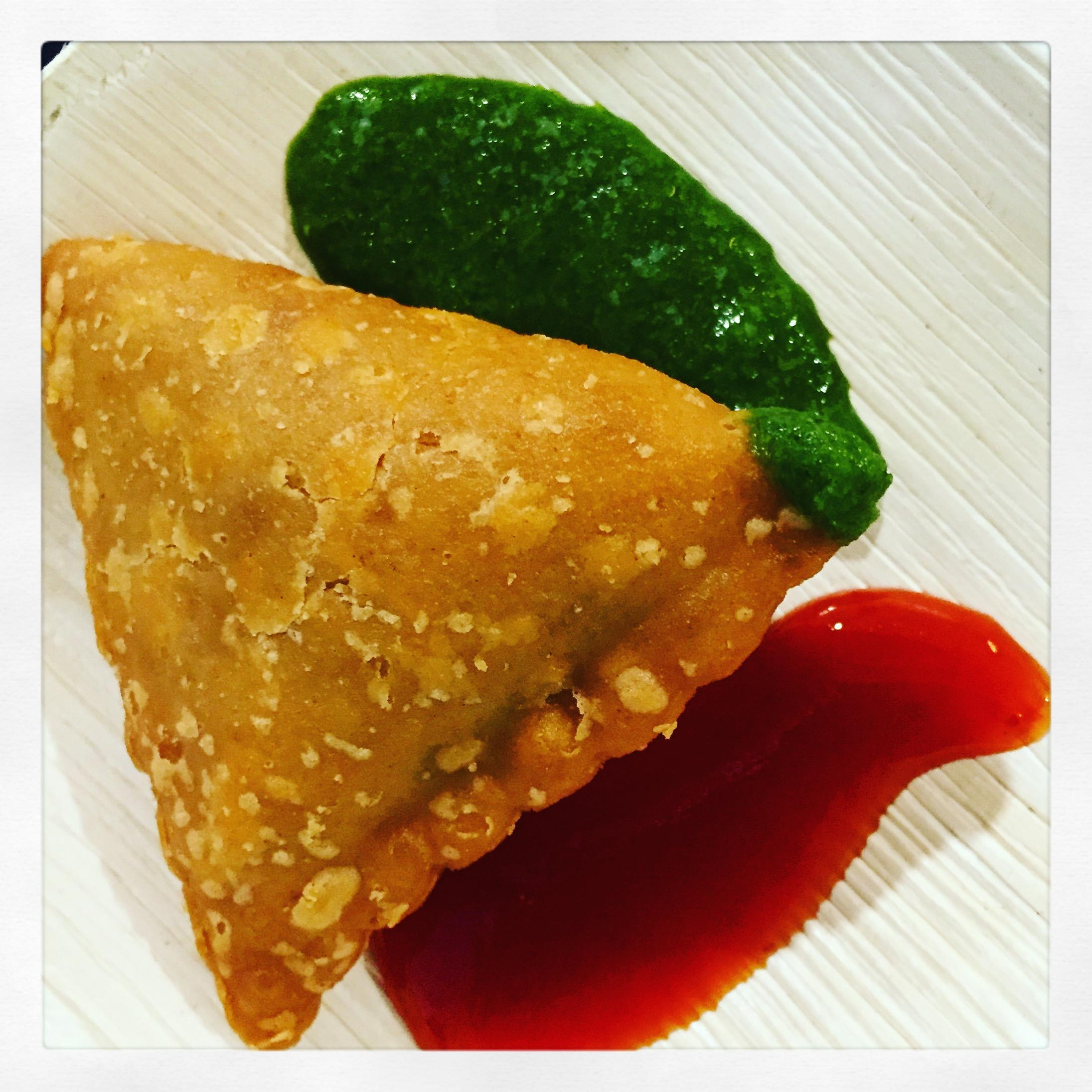 Delectable samosas with fresh made cilantro mint chutney and hot & sweet ketchup at Bombay Wraps